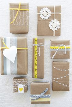 Brown craft paper or brown paper bags recycled. There are some really cute ideas at this site. I really love the paper bird cut from an old card, magazine, or where ever that looks to be mounted to cardstock to make it stiffer and attached to a small tree twig to decorate the package. Check out the site and get loads of cute and different ideas for wrapping gifts. - Pam