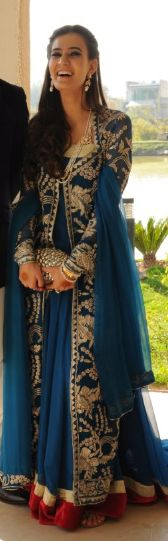 Blue lehenga with gold and red accent.