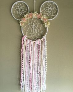 Boho Minnie Mouse Floral Dreamcatcher Unique handmade item Pink and white Minnie Mouse Inspired Dreamcatcher. Large size Dreamcatcher. Made with trims, yarns, florals, and wood. Perfect for: Birthdays, parties, nurseries, home decor, or gifts Sold by luneradreams on etsy. Made in NJ #handmadehomedecor