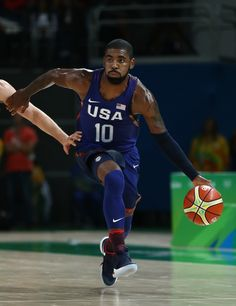 Kyrie Irving Photos Photos - Kyrie Irving #10 of United States moves the ball during a Preliminary Round Basketball game between Australia and the United States on Day 5 of the Rio 2016 Olympic Games at Carioca Arena 1 on August 10, 2016 in Rio de Janeiro, Brazil. - Basketball - Olympics: Day 5