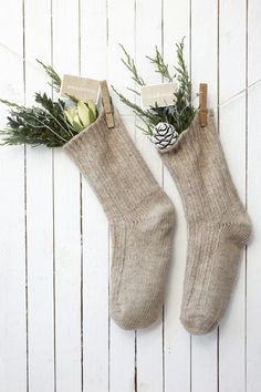 la petite cuisine: so british: natural christmas stockings - next yr fill ours w/ greens and natural pieces Noel Christmas, Merry Little Christmas, Rustic Christmas, Simple Christmas, Winter Christmas, Christmas Stockings, Christmas Crafts, Knit Stockings, Christmas Presents