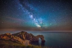 The spectacular photos capture the 'gateway to the Milky Way' as it passes through Durdle Door in Dorset They were taken at midnight by astro-photographer Stephen Banks using a bright LED torch. Milky Way Pictures, Cool Pictures, Inspiring Pictures, Amazing Photos, Beautiful Pictures, Astronomy Pictures, Jurassic Coast, To Infinity And Beyond, Stargazing
