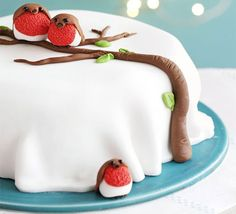 Rocky robin cake. use strawberrys for the robins and a tootsie roll for the tree and regular frosting spread smooth