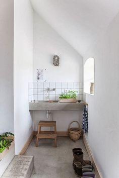concrete sink with tile backsplash
