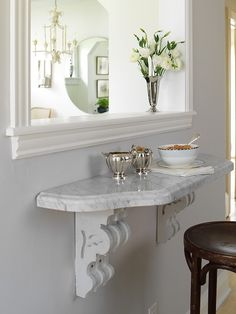 Suzie: Margot Austin - Sweet foyer with marble shelf, gray walls paint color and wood counter ...
