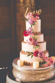 Our beautiful custom wedding cake by Raindrop Desserts for our barn reception.