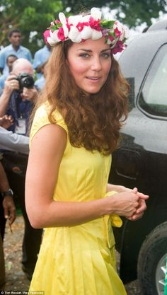 Kate looked stunning in a yellow dress and flower head dress as she toured Tuvalu