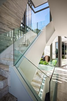 Modern Stairs // glass and stone stairs at a family home With 270° views In Cape Town by SOATA and Janie Lazard Interiors