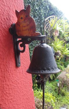rustic bell with cat decor
