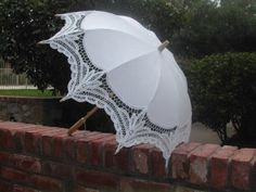 Wedding Parasol lace-parasols,http://www.amazon.com/dp/B0029E04TM/ref=cm_sw_r_pi_dp_FZU9sb19VPF3QT0P