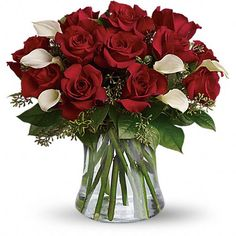 Be Still My Heart - Dozen Red Roses  The look of love is charmingly reflected in this romantic array of red roses and fragrant white callas. Beautifully presented in a sparkling glass vase, these gorgeous flowers will say what's in your heart more eloquently than words.