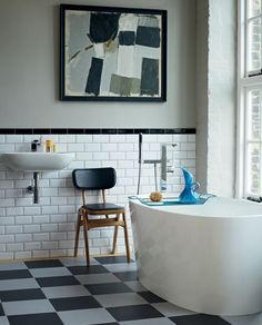 Metro tiles in the bathroom and black and white checkerboard tiles. I just love brick style tiles because they remind me of New York loft bathrooms and the London Underground – classic looks from two of my favourite cities Metro Tiles Bathroom, Loft Bathroom, Room Tiles, Bathroom Interior, White Bathroom, Wall Tiles, Master Bathroom, Bathroom Colours, Classic Bathroom