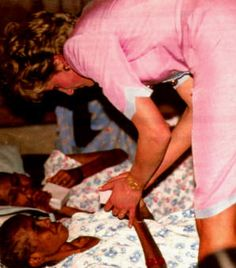 Princess Diana comforting an AIDS patient at Mother Teresa's Hospice for the Sick and Dying in Calcutta in 1992.