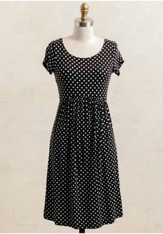 The perfect combination of darling and chic, this mini dress features a sweet, polka-dot print in hues of black and cream. Style this dress for a day spent shopping in town with your girlfriends. Unlined, opaque.