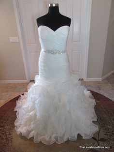 Description Allure Bridals Wedding Dress Style W353 Strapless fit and flare organza bridal gown with a sweetheart neckline and pleated bodice. A beaded bodice accents the natural waist and ties in the