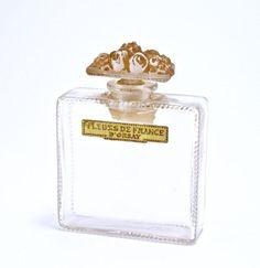 1920 R. Lalique, D'Orsay Fleurs de France perfume bottle, clear glass, frost stopper, brown patina, label. Lalique mark. 3 1/4 in.