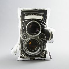 Vintage fiends and photography buffs will love the cotton sateen Rollei Pillow. Featuring the image and shape of a vintage Rolleiflex camera, the pillow takes couch art to a whole new level.