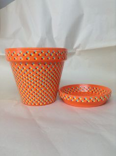 A personal favorite from my Etsy shop https://www.etsy.com/listing/233586502/6-inch-hand-painted-orange-flowerpot