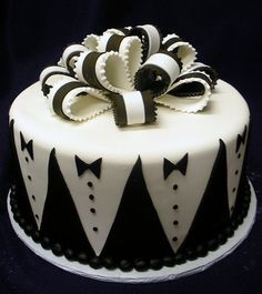 Grooms cake with tuxedo patterns and black and white bowtie