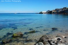 Coverack beach and harbour, by Jane Mucklow Photography.