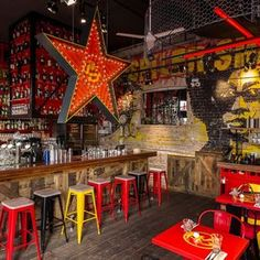 There's urban mural art happening and industrial girder-like steel frames painted the vivid red of good luck and communism. Head downstairs to the secret bar, however, and the subdued lighting coupled with the continued red and gold theme gives a sense of intrigue and old time glamour to proceedings...