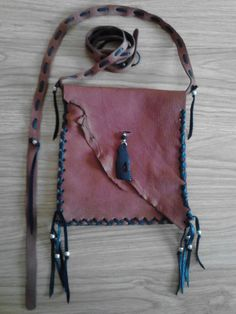 Welcome~    This Traditional Native American Pouch (Bag) is completely Handmade AND Total Quality.....  I used Premium Whiskey and Black Deer Hide in
