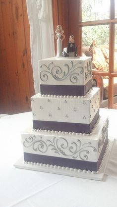 3 tier square wedding cake                              …