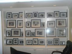 black and white photos in a glass enclosed book shelf