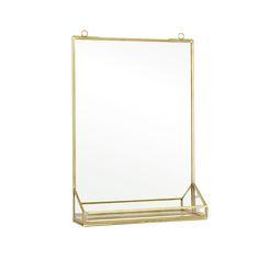 Söt tunn och lätt spegel som passar i alla rum. Spegel med hylla i metall.  Söt och smidig badrummsspegel & sovrumsspegel  i klassisk mässingsfärg.