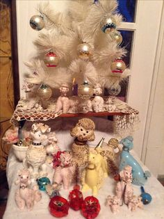 Vintage Poodle Christmas. Fun, querky- maybe i should do this with my fairy collection - or is it to close to crazy catlady?