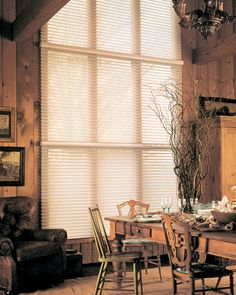Silhouette® window shadings blends American tradition and innovation to create a rustic fall dining room decor. ♦ Hunter Douglas window treatments