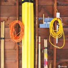 Organise your home with this easy garage organisation idea! Wrap up loose items with VELCRO® Brand ONE-WRAP® Reusable Ties and stick tools to the wall with VELCRO® Brand Heavy Duty Tape. An easy way to keep your garage organised and save space! Kitchen Organisation Hacks, Life Organization, How To Be More Organized, Staying Organized, Organizing Your Home, Organising, Recycled Jars, Tiki Torches, Shower Accessories
