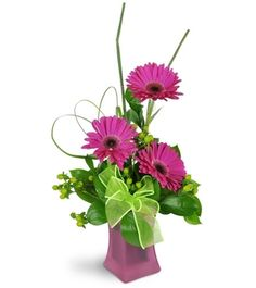 Bright pink gerbera daisies are perfectly complimented by green hypericum berries and a lime green ribbon. A lovely pink glass vase is the finishing touch! Creative Flower Arrangements, Ikebana Arrangements, Floral Arrangements, Pink Gerbera, Purple Roses, Gerbera Daisies, Altar Decorations, Flower Decorations, Different Flowers
