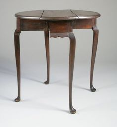 Diminutive Queen Anne Maple Drop-Leaf Table  with Rounded Leaves    New England, probably Connecticut, 1740-1780  H. 27 in.; L. 28 ¾ in.; W. (closed) 11 1/8 in.; D. (open) 27 3/8 in.    This delicate table retains much of its original reddish wash --applied to the maple to make it appear as mahogany. This was often done- in both urban and rural areas- so that a native wood would appear as much more expensive imported mahogany.