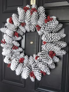 Wire wreath form, pinecones from backyard, glue gun, spray paint, viola!  If pinecones are fully open, bake in oven at 200 for 1/2 an hour.  Cost...Less than $15.  Saw one on Etsy that was not as pretty for five times that!