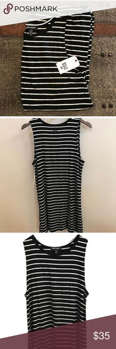 NWT Billabong Last Call Tank dress stripped large NWT Billabong Last Call Dress size Large. Sure soft and and lightweight black and white stripped tank dress. Billabong Dresses Mini