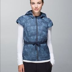 Size 6 Lululemon Spring Fling Puffy Vest Blue Only worn a couple of times to run errands and washed once, gentle cycle(cold) and laid flat to dry. Has removable hood and can be cinched at waist to show figured. Price is $65 obo Cross posted lululemon athletica Tops Sweatshirts & Hoodies