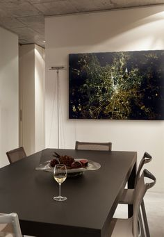 "Contemporary dining room with large statement art ""Berlin At Night From Space"" by Chris Hadfield via @greatbigcanvas available at GreatBIGCanvas.com."