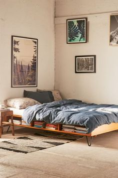 Great use of otherwise ignored space. Important for small space living | Border Storage Bed - Urban Outfitters