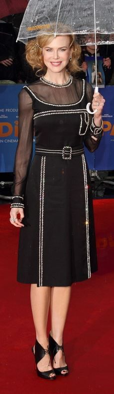 Who made  Nicole Kidman's black long sleeve dress, purse, and tie shoes that she wore in London?