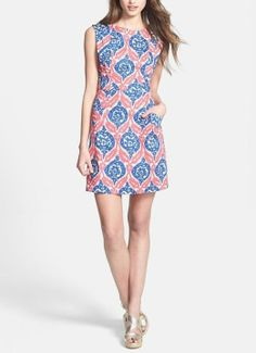 Love the beautifully placed pleats on this medallion print dress!