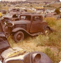 1932 Ford 3 window in a wrecking yard