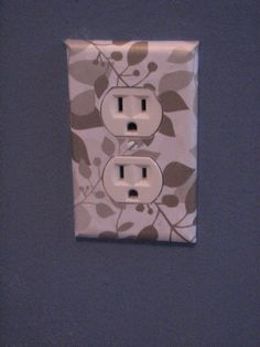 Cover wall outlets w/scrapbook paper. What a cute way to add character to a room.