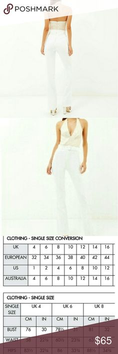 White and gold pants jumpsuit River Island white and metallic gold plunging jumpsuit   size 8 us and 10uk  Inseam 35  Same-day shipment before 3 p.m. on weekdays and 1 p.m. on weekends river island  Pants Jumpsuits & Rompers