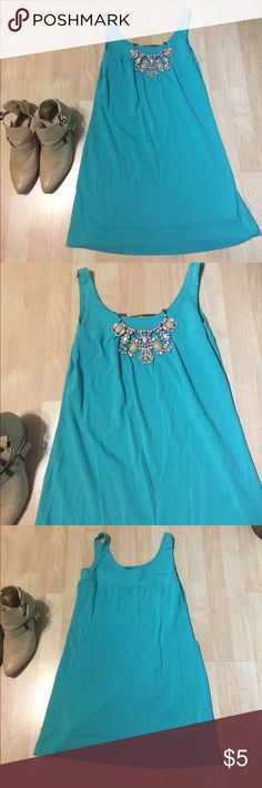 New York and company dress Please read!! This item is priced low due to condition. There is small discolorations on the bottom of the back of the dress. Please see pictures. These appear to be bleach stains so they will not come out. Price is firm. New York & Company Dresses