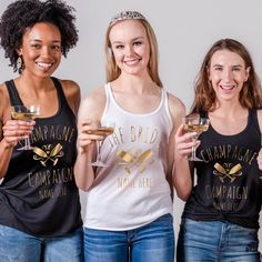 Hey there, champagne campaign! Customize a cute, gold metallic tank top to wear out during the bride's bachelorette bash! Make sure you check out the matching metallic version for the bride to wear. Bachelorette Party Shirts, Bachelorette Weekend, Custom Tanks, Flowy Tops, Champs, Color Change, Bliss, Champagne, Metallic