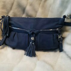 Beautiful leather bag This is an all leather bag with silver accents  long handle that you can adjust  fringe detail two pockets on the front zipped  more pockets on the inside  it's beautiful it's a deep dark blue almost a denim blue I never used it b. makowsky Bags Shoulder Bags