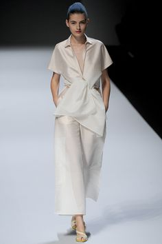 Issey Miyake, Japan.  This is a really cute designer wear that I have a similar one of his patterns that he makes for Vogue.  Got to make it.