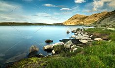 Mountain lake Photos Quiet mountain lake in a sunny afternoon. by Anaphotos