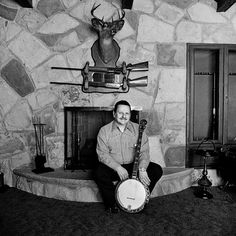 "Ralph Stanley at Home, Coeburn, Va., 1974. ""As bluegrass heroes go, Ralph Stanley is right up there with Bill Monroe. He began performing with brother Carter as the Stanley Brothers in 1946, and their old-time mountain sound has been hugely influential."" Photo by Henry Horenstein."